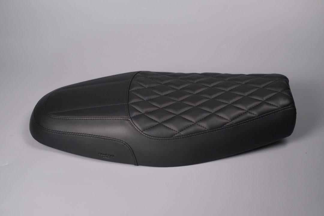 A unique dual seat inspired by a slick shape details and materials from sport car interior design to completed sport classic looks for your Triumph